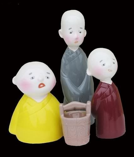 296: A set of cold porcelain figurines of three monks
