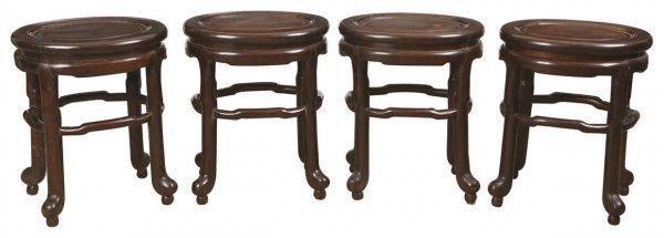 10: Set of four Chinese egg shaped rosewood stools