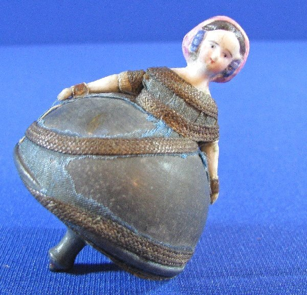 248: RARE FIGURAL DOLL SPINNING TOP