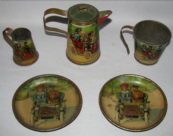 18: PARTIAL GERMAN TIN LITHO AUTOMOTIVE TEA SET