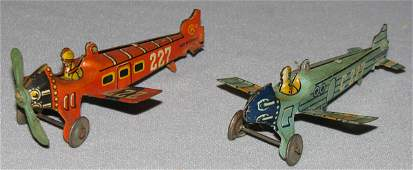 112 TWO KELLERMAN PENNY TOY AIRPLANES