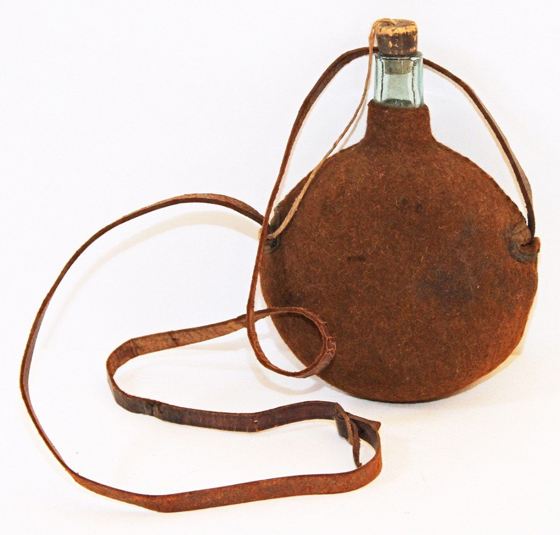 33: OLD CLOTH COVERED GLASS CANTEEN