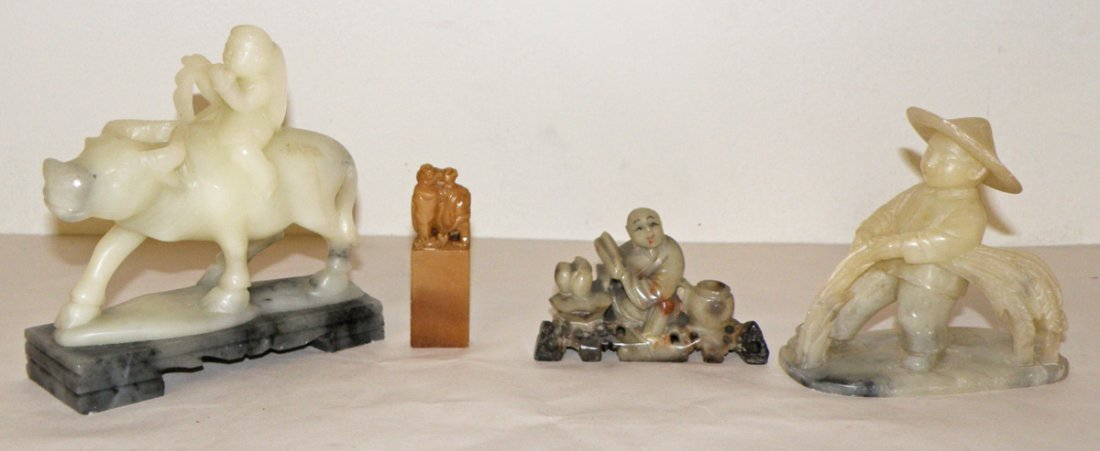 18: FOUR CARVED SOAPSTONE FIGURES WITH PEOPLE