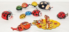 FIVE WIND UP JAPANESE TOY BEETLES