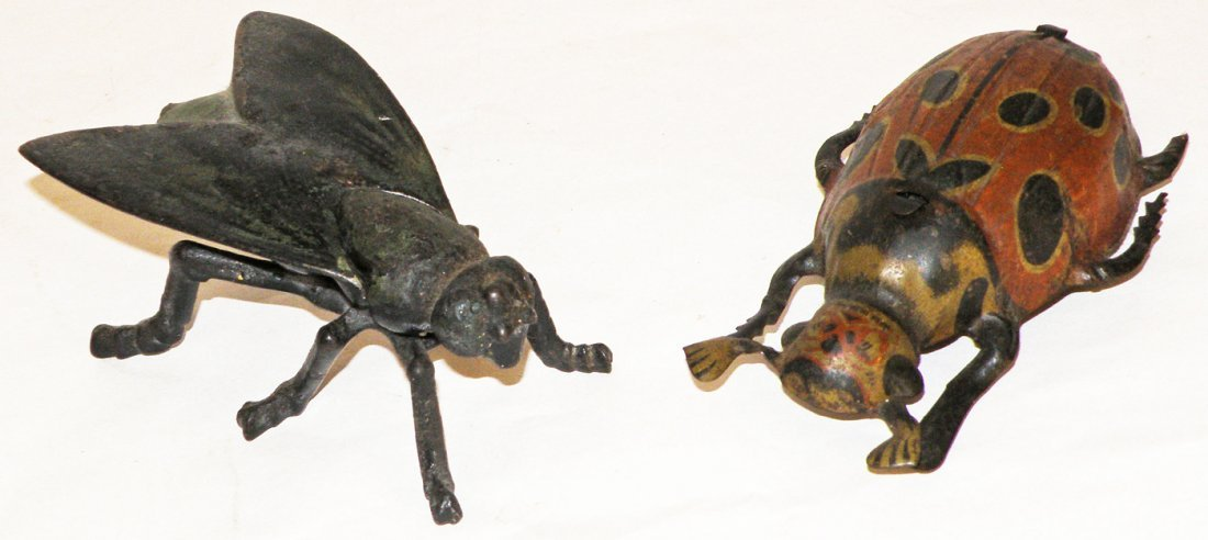 100: TWO TOY BEETLES