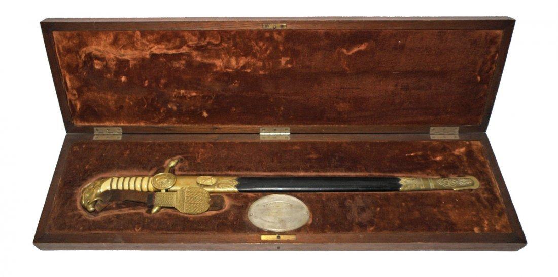 85: EAGLE HEAD PRESENTATION SWORD IN CARVED  OAK CASE