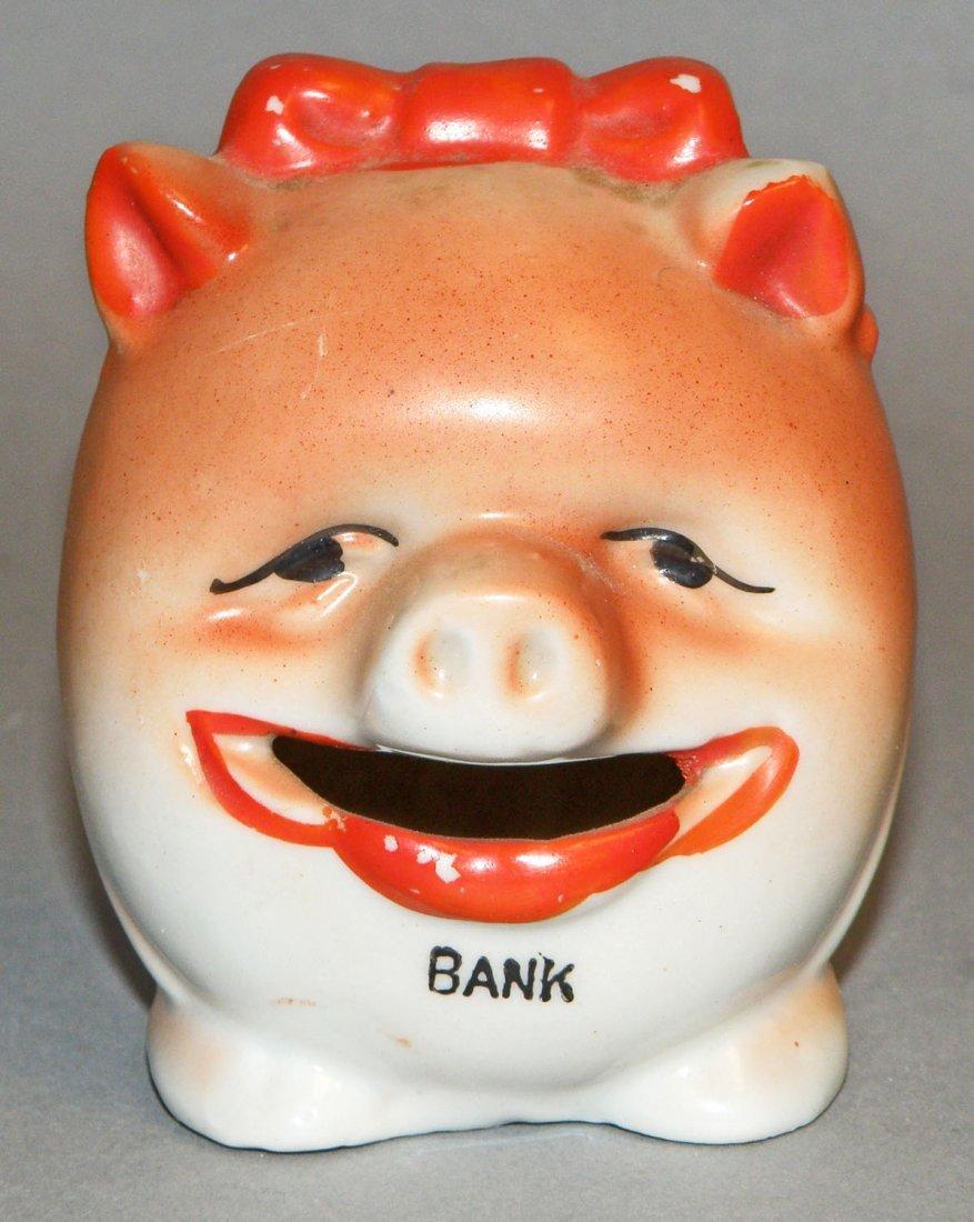 11: PORCELAIN PIG FACE STILL BANK