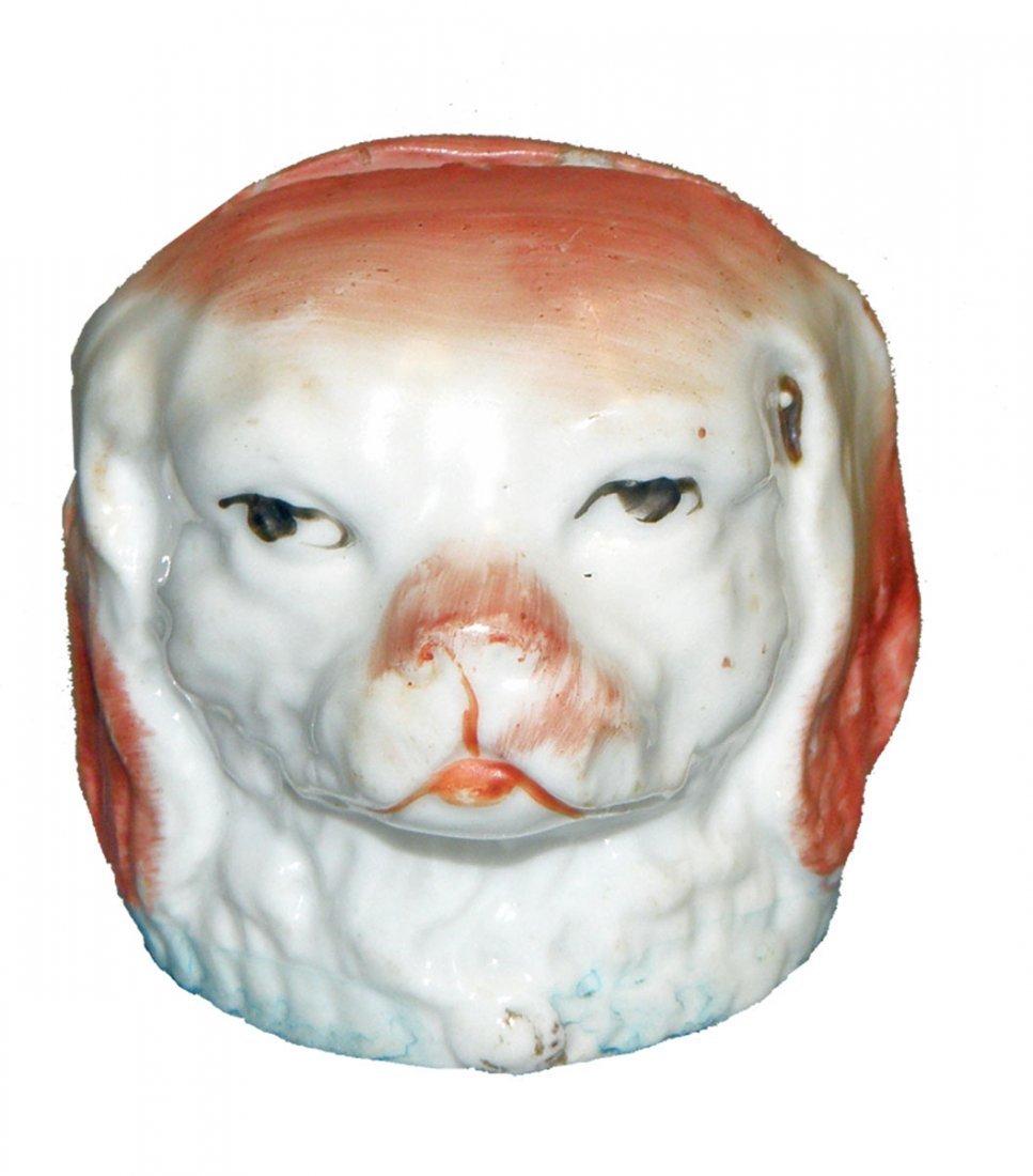 22: STAFFORDSHIRE POTTERY DOG HEAD STILL BANK