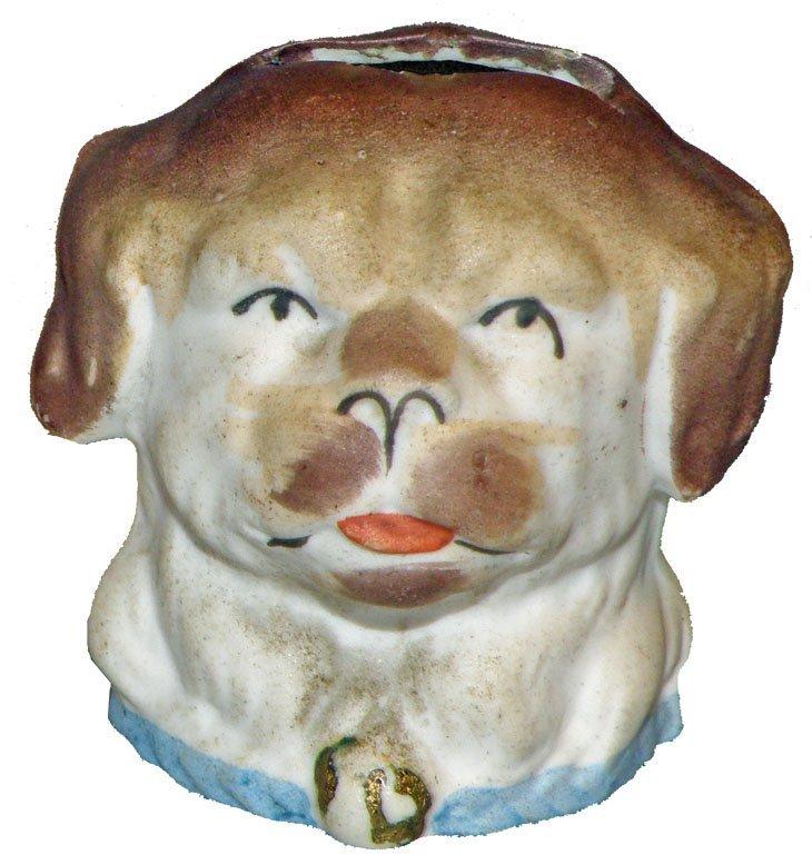 24: STAFFORDSHIRE POTTERY DOG HEAD STILL BANK