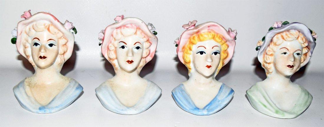 FOUR HEAD VASES