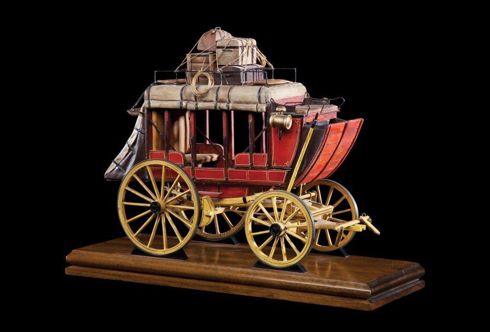 10: Four (4) Miniature Wagons by Oscar M. Cortes