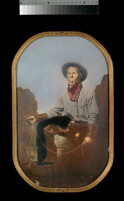 14: Hand tinted 1890's cowboy photograph 10 x 16,