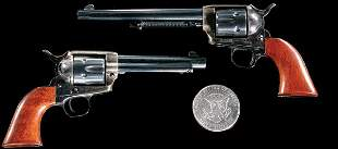 Pair of mini replicas of the Colt Single Actions