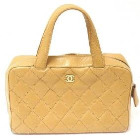 CHANEL VINTAGE GOLD LAMBSKIN GOLD LOGO LEATHER HANDBAG