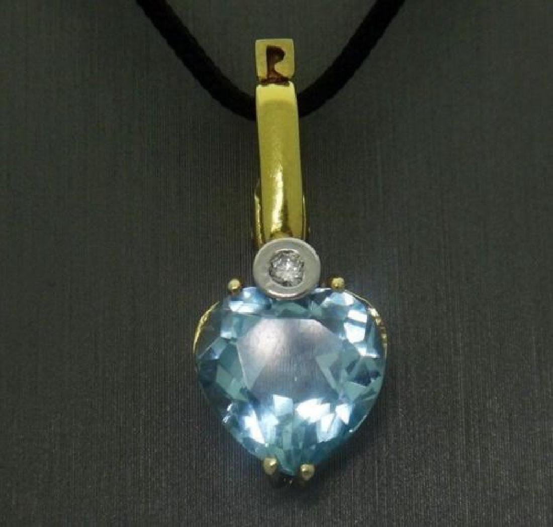 "14k Gold Aquamarine & Diamond Pendant on 17"" Cord"