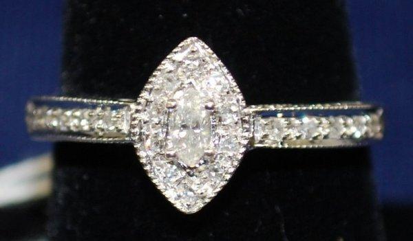 4: 14KT W.G. DIAMOND RING .50CT