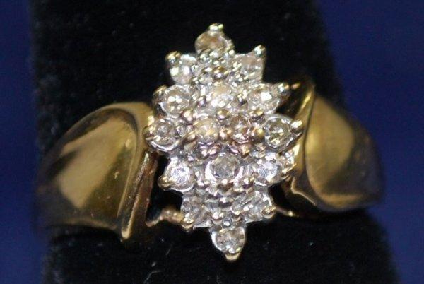 11: 10KT Y.G. DIAMOND CLUSTER RING