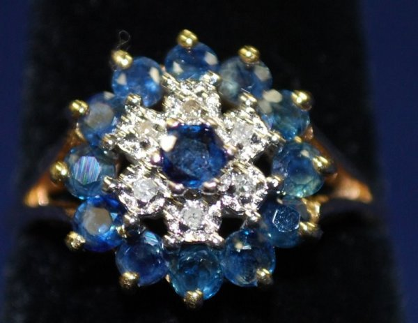 21: 10KT Y.G. SAPPHIRE AND DIAMOND RING