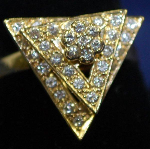 24: 14KT Y.G. DIAMOND TRIANGLE RING