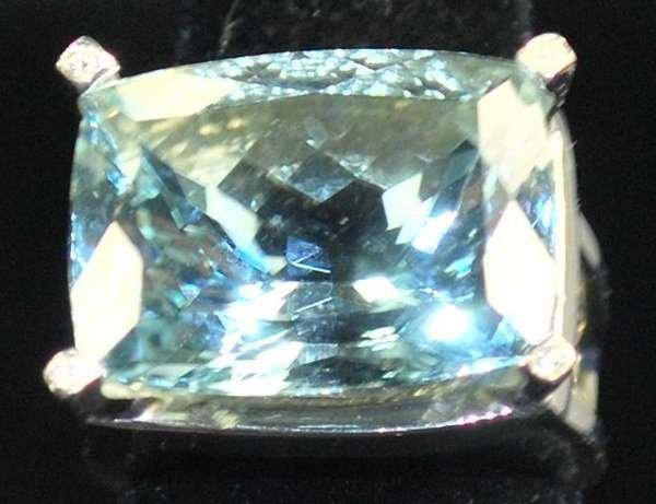 11: LADIES 18KT W.G. AQUAMARINE AND DIAMOND RING