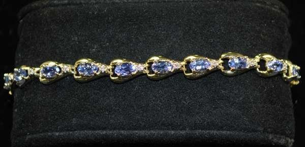3: 14KT Y.G. TANZANITE AND DIAMOND BRACELET