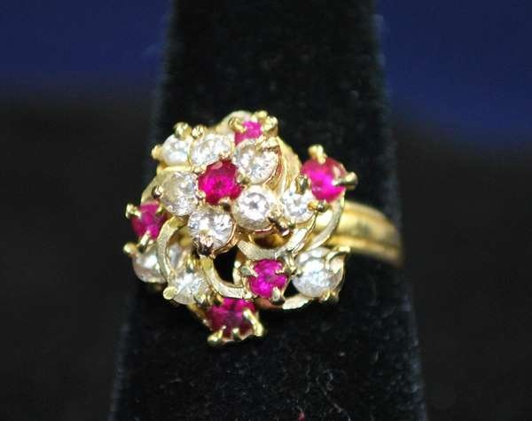 8: 14KT Y.G. RUBY AND DIAMOND RING