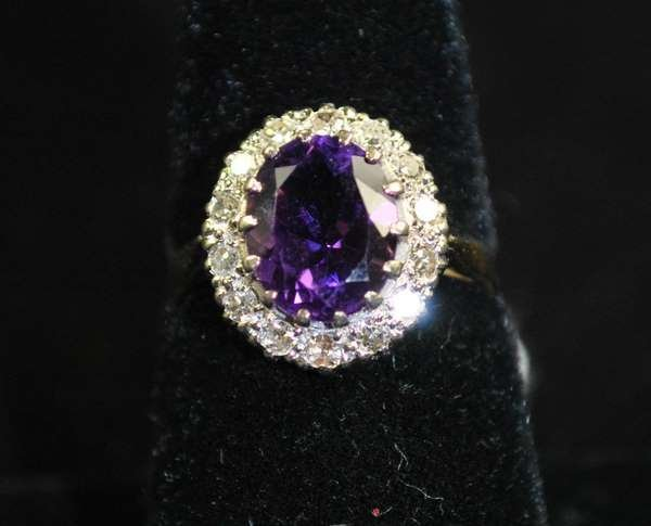 9: 14KT Y.G. AMETHYST AND DIAMOND RING