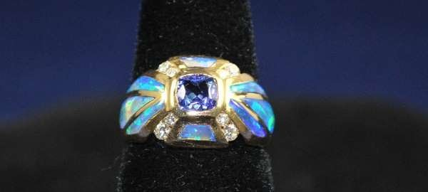 10: 14KT Y.G. TANZANITE AND DIAMOND RING