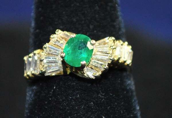13: 14KT Y.G. EMERALD AND DIAMOND RING
