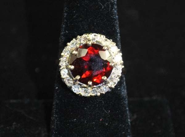 14: 14KT Y.G. GARNET AND DIAMOND RING