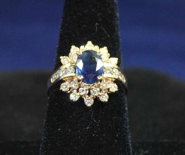 6: 14KT Y.G. SAPPHIRE AND DIAMOND RING