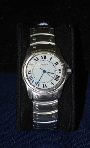 100: LADIES S/S CARTIER SANTOS BOX AND PAPERS
