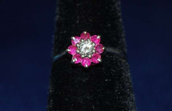 105: 14KT W.G. RUBY AND DIAMOND RING .75CT