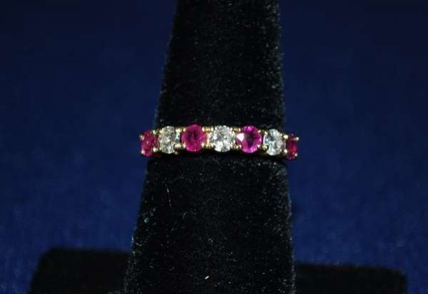 113: 14KT Y.G. RUBY AND DIAMOND BAND .75CT