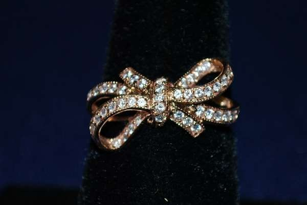 115: 14KT P.G. DIAMOND BOW RING .50CT