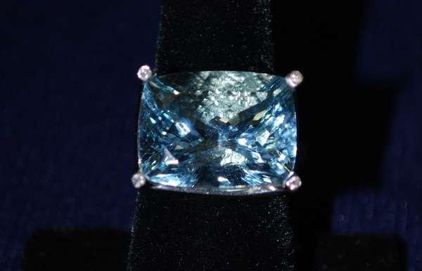 116: LADIES 18KT W.G. AQUAMARINE AND DIAMOND RING