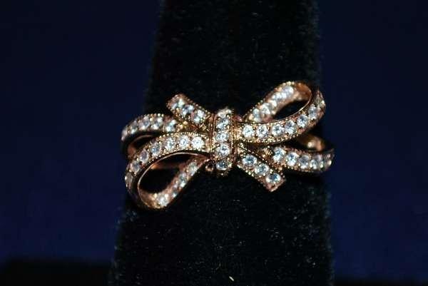 15: 14KT P.G. DIAMOND BOW RING .50CT