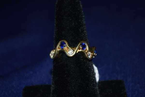 3: 18KT Y.G. SAPPHIRE AND DIAMOND RING