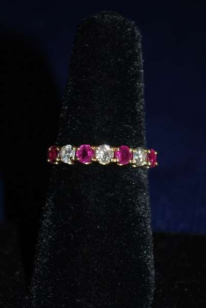 10: 14KT Y.G. RUBY AND DIAMOND BAND 1.00CT