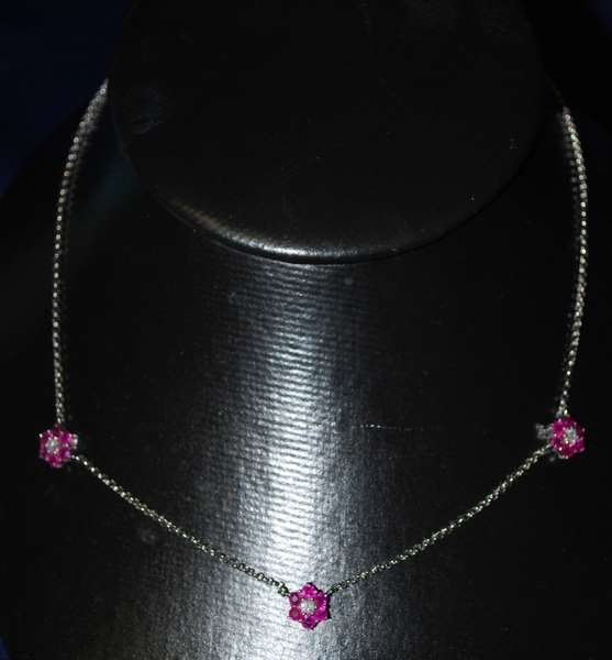 20: 18KT W.G. RUBY AND DIAMOND NECKLACE 2.00CT
