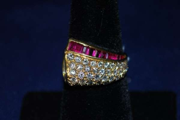 13: 18KT Y.G. SIGNED KRYPELL RUBY AND DIAMOND RING