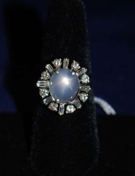 18: 18KT W.G. STAR SAPPHIRE AND DIAMOND RING