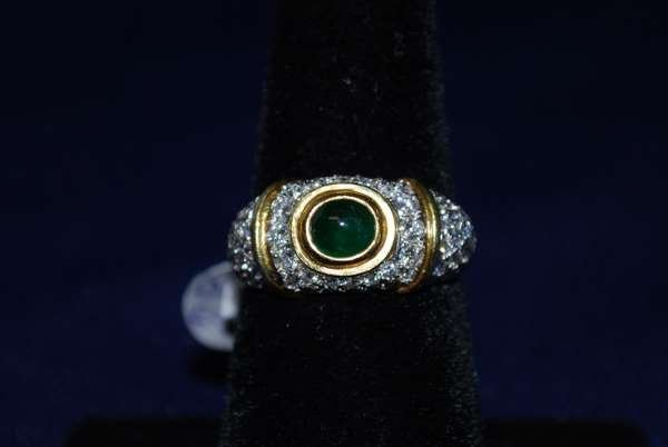 22: 18KT Y.G. EMERALD AND DIAMOND RING
