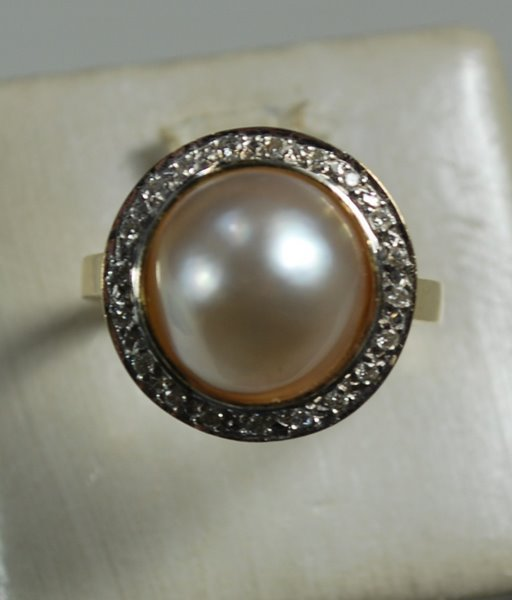 24: 14KT Y.G. PEARL AND DIAMOND RING