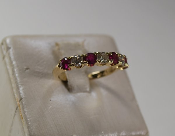 7: 14KT Y.G. RUBY AND DIAMOND BAND .70CT