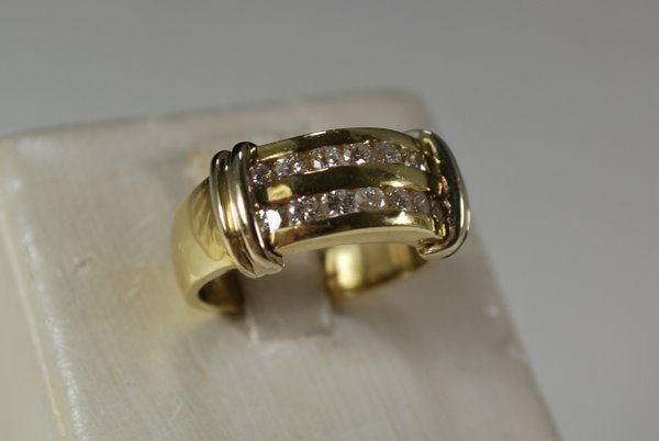 12: 14KT Y.G. .85CT DIAMOND BAND
