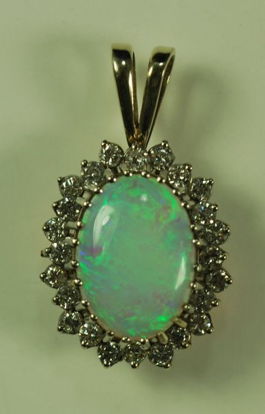 17: 14KT W.G. OPAL AND DIAMOND PENDANT7.50CT