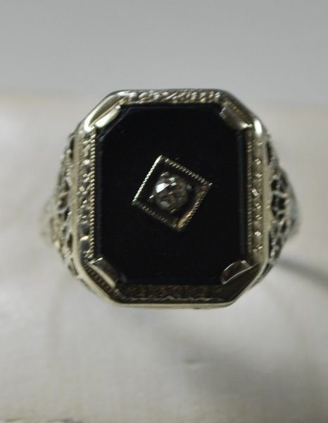 8: 14KT W.G. 1930'S ONYX AND DIAMOND RING