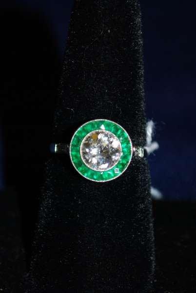 104: PLATINUM ART DECO EMERALD AND DIAMOND RING