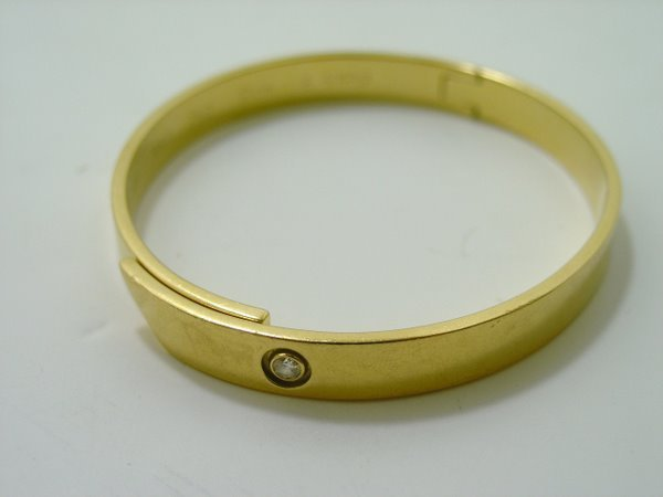 21: 18KT Y.G. CARTIER DIAMOND BANGLE